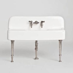 White sink with silver taps and legs