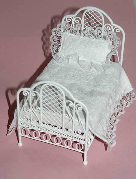 Bed single white wire frame & lacy doona