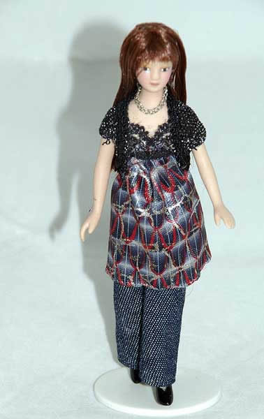 Fashionable doll in jeans, porcelain
