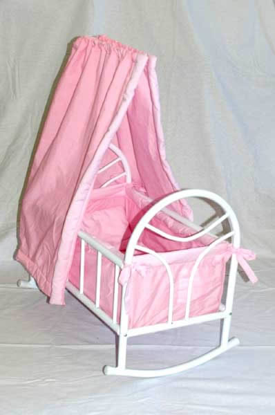 Pink rocking cradle with white frame
