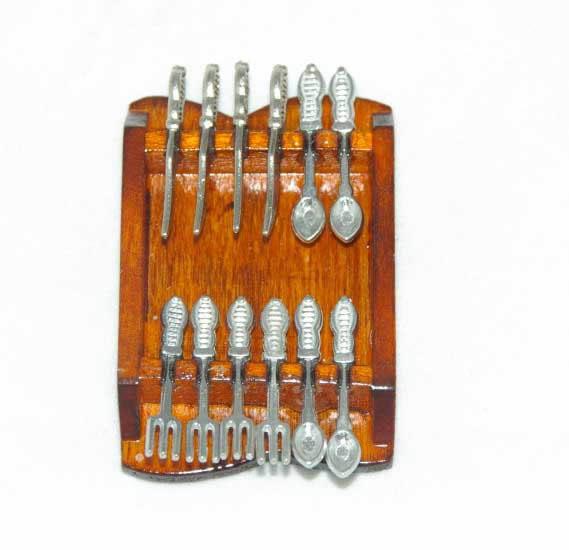 Silver cutlery set on wall mount
