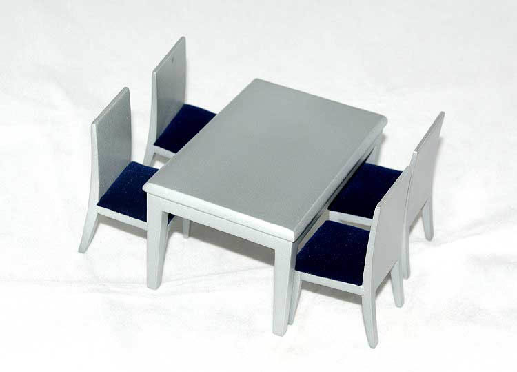Silver table with 4 navy blue seated chairs