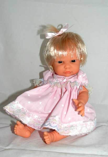 Bath baby doll in pink dress with blonde hair