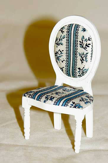 White chair with blue paisley pattern