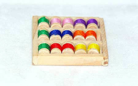 Coloured cotton rolls in tray