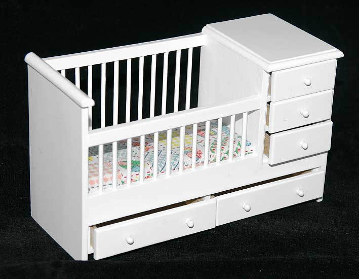 White cot with drawers