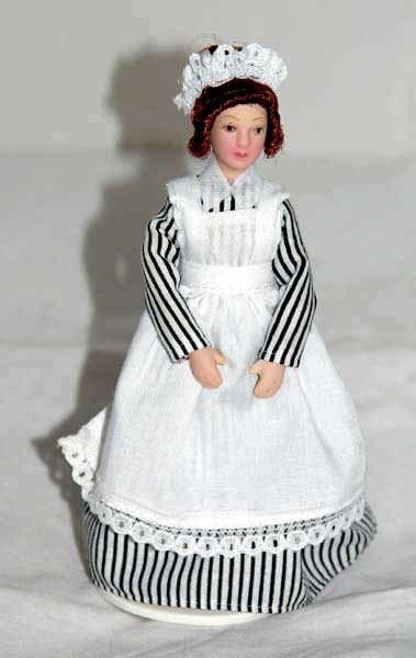Young maid in striped dress