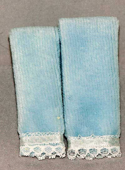 Blue folded pair of towels