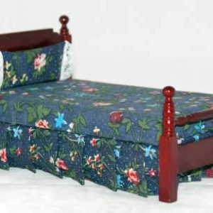 Single bed with navy blue floral covering