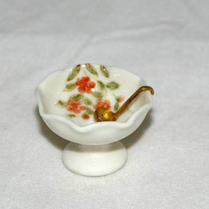 Punch bowl and gold serving spoon, porcelain