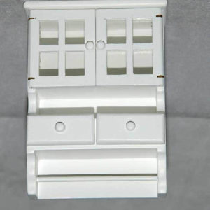Kitchen wall cupboard with towel rail