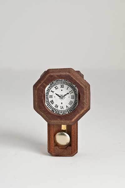 Old fashioned pendulum wall clock
