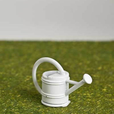 White garden watering can