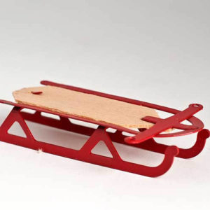 Red sled with pine base