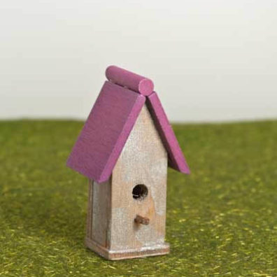 Bird house with pink roof