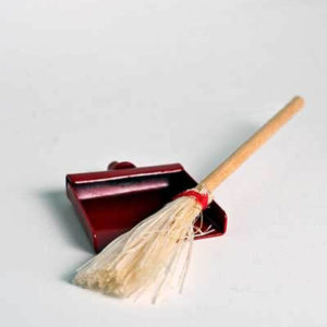 Straw broom and red dust pan