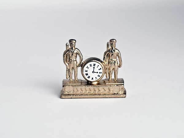 Gold clock with two saluting soldiers