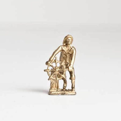 Gold fisherman figure