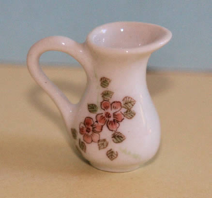 White jug with  pink flowers