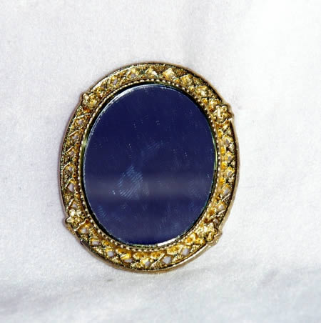 Mirror oval, gold detailed frame