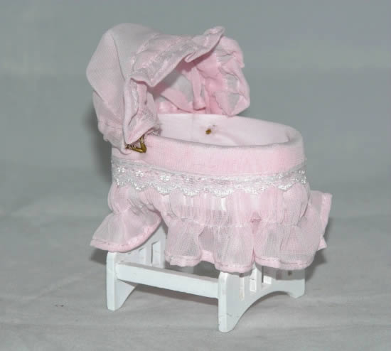 Pink cradle with adjustable hood