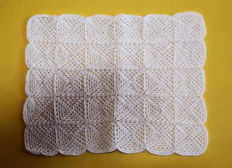 White hand crocheted throw rug