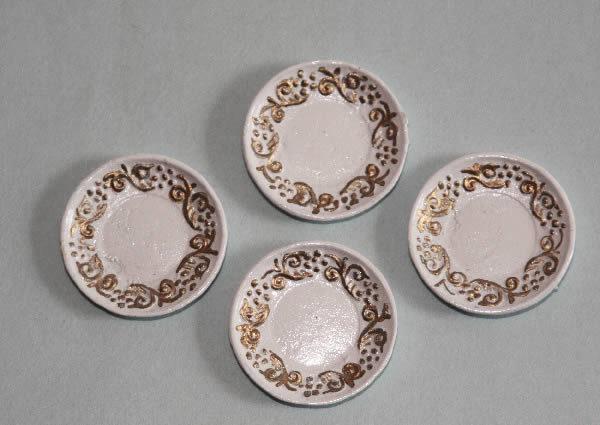 Plates, gold trim, set of four