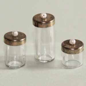 Glass canisters, brass lids