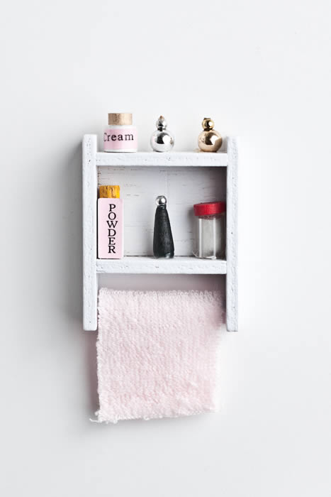 Stocked bathroom shelf