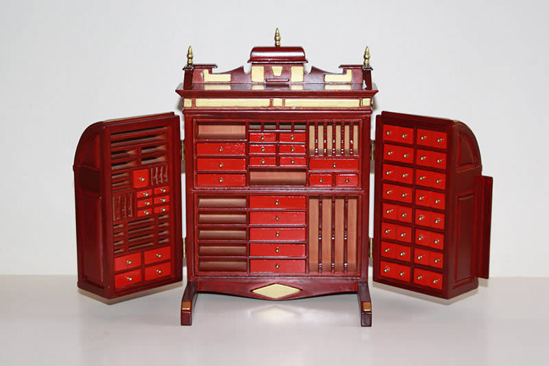 Collector's cabinet  mahogany with gold trim