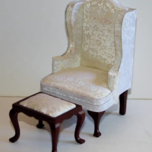 Cream silk wing back chair and stool
