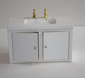 White timber sink and cupboard