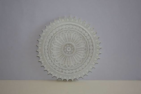 Ceiling rose heavily decorated