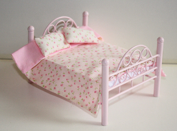 Pink metal bed and covers