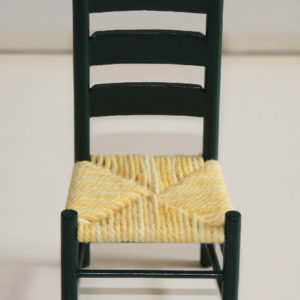 Green chair with cane seat