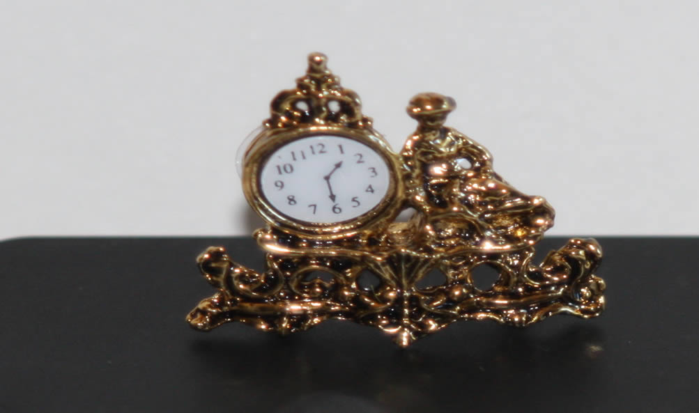 Gold mantle clock with figurine