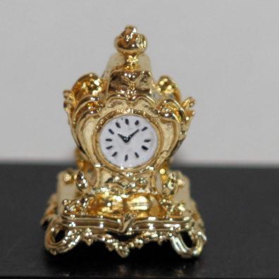 Gold metal mantle clock