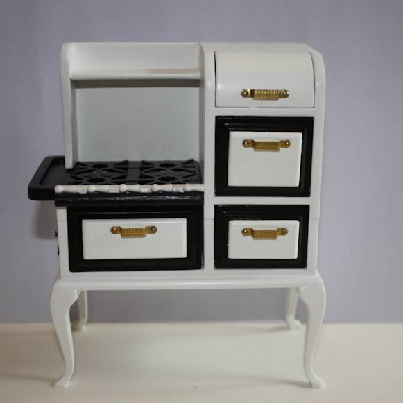 White gas stove with black top