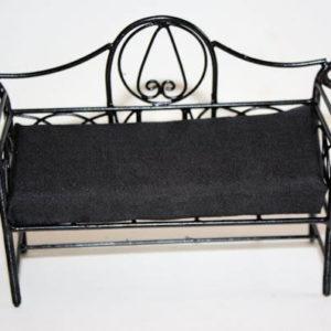 Black wire decorated garden bench