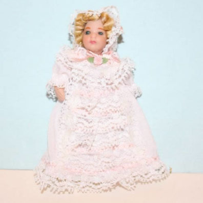 Porcelain doll with white ruffle dress