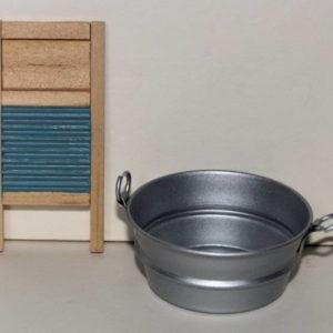 Round metal wash basin and board.
