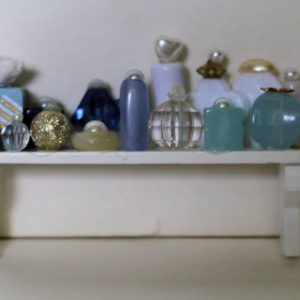 White timber bathroom shelf witgh toiletries