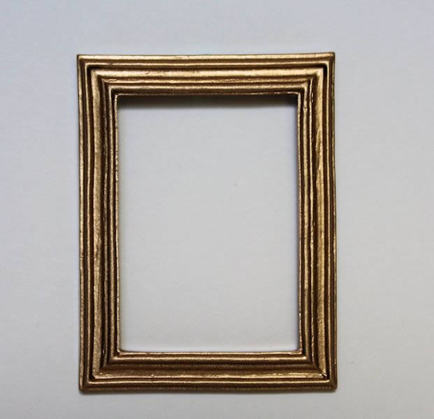 Gold ribbed picture/mirror frame