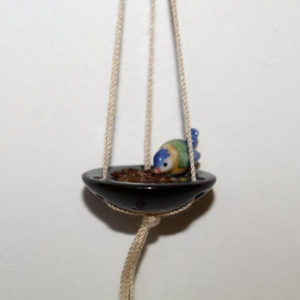 Ceramic hanging bird bath or feeder with bird