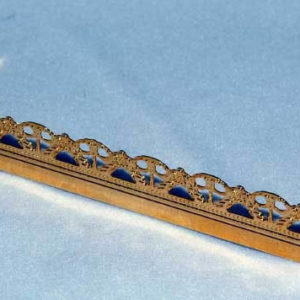 Long gold fire fender with ornate edge