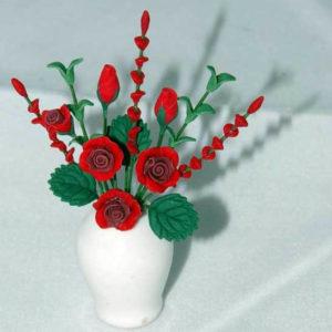 Red roses in white vase