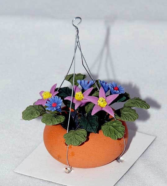 Hanging flower pot with purple flowers