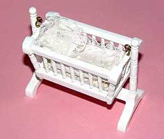 White rocking cradle with covers