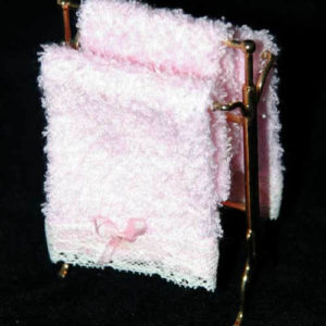 Gold towel rack with pink towels