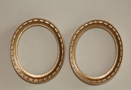 Gold double decorated oval frame